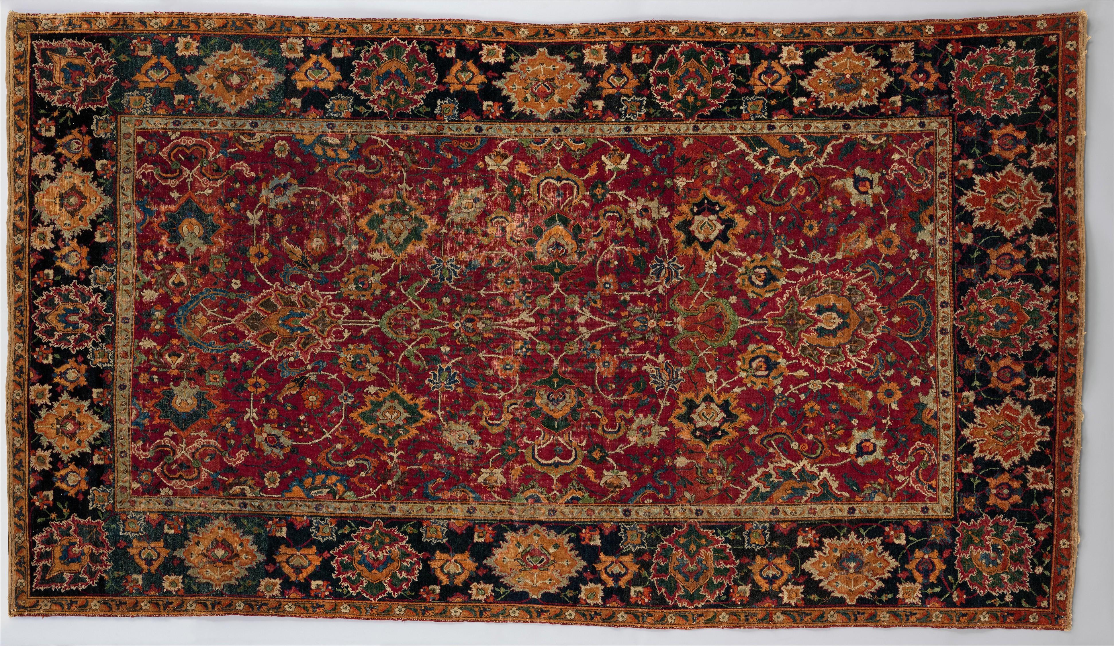Tapis à fleurs et bande de nuages, XVIIe siècle. Soie, laine et nouage asymétrique © MET Museum.