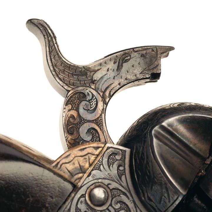 Détail de la tête de loup gravé par Gustave Young sur le chien des revolver qu'il grave en guise de signature. © Rock Island Auction