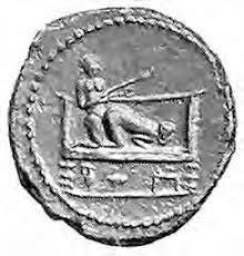 Spintria du premier groupe distingué par Campana. L'homme tient dans sa main une vindicta. Ier siècle de notre ère © archaeometry.org
